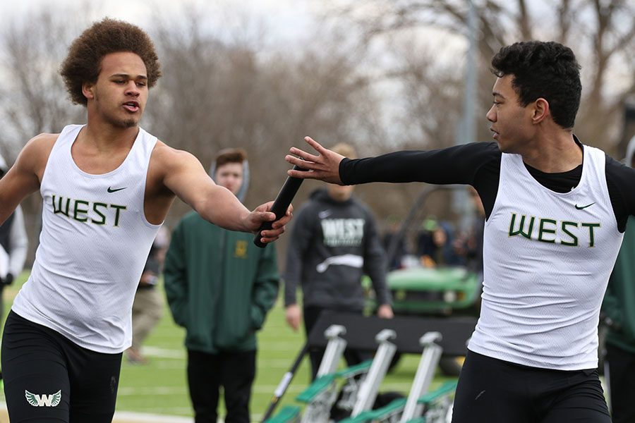 Mekhi Johnson 20 hands the baton off to Chris Caruthers 20, the third runner during the 4x200 meter relay on Saturday, April 13. The Trojans placed seventh in 1:45.99.