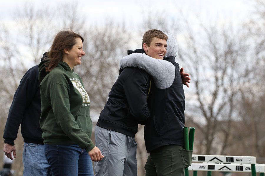 Cole Mabry '19 hugs head track and field coach Travis Craig during the senior recognition ceremony on Saturday, April 13.