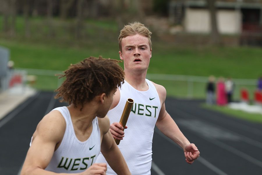 Nick Johnson '19 sprints to hand off the baton to Tyuss Bell '21 during the 800 meter relay on Thursday, April 18. The relay team finished fifth in a time of 1:39.70.