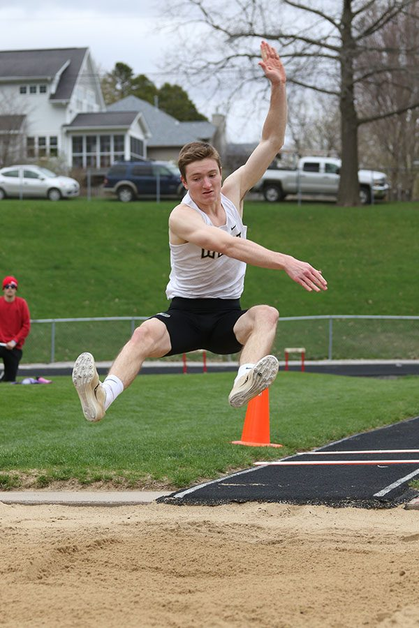 Ryan Gudenkauf '19 takes his second jump of the night on Thursday, April 18. Gudenkauf placed seventh with a jump of 20-01.75.
