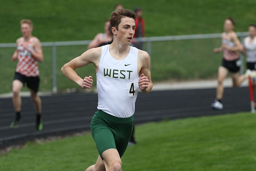 Kolby Greiner leads the 3,200 meter run on Thursday, April 18. Greiner placed first in 9:40.06. He also placed first in the 1,600 meter run in 4:28.50.