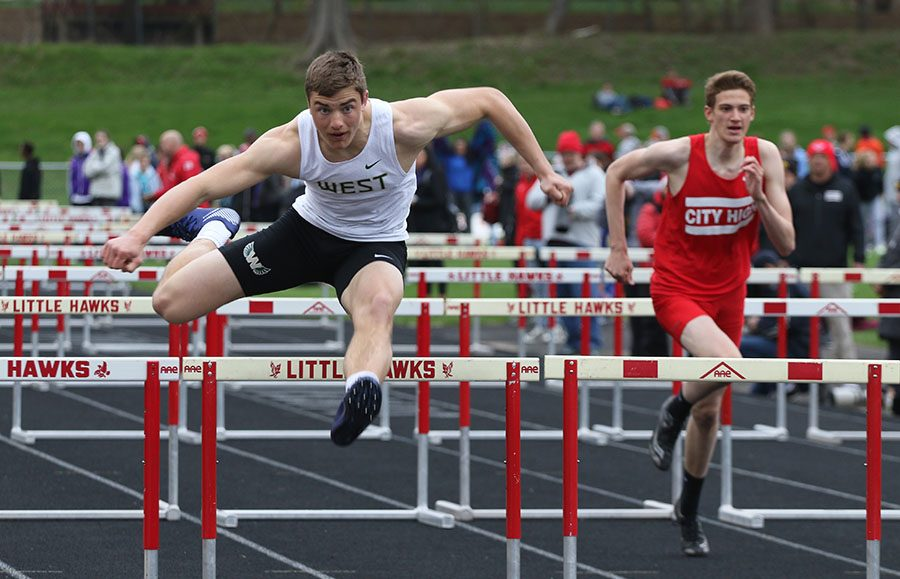 Cole Mabry '19 goes over the last hurdle of the second leg of the shuttle hurdle relay on Thursday, April 18. The relay team also consisting of Jason Lu '21, Mabry, Anuj Jani '22 and Ryan Gudenkauf '19 placed second in 1:04.19.