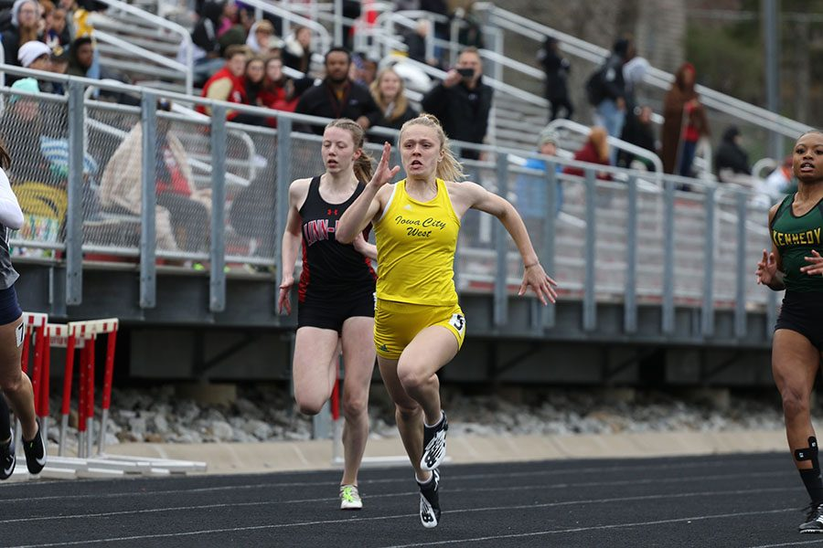 Peyton Steva '19 leads during her heat of the 100 meter dash. Steva placed first in 12.63 on Thursday, April 18.