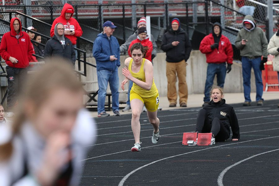 Clare Loussaert '22 sprints off the blocks at the beginning of the 400 meter run on Thursday, April 18. Loussaert finished ninth with a time of 1:08.85.