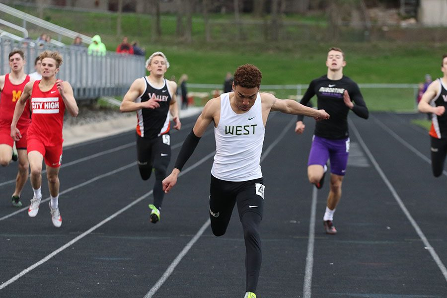 Gabe Caruthers '19 crosses the finish line during the 400 meter run on Thursday, April 18. Caruthers won the race in a time of 48.88, for which he was awarded the Dick Feeney award after the race.