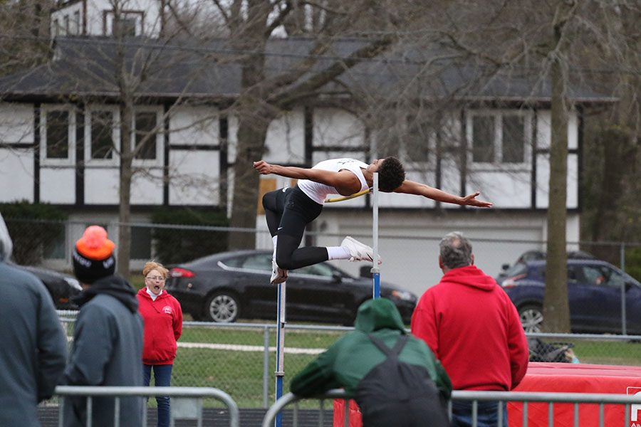 Marcus Morgan '21 competes in the high jump. He placed second with a jump of 6-03.25.