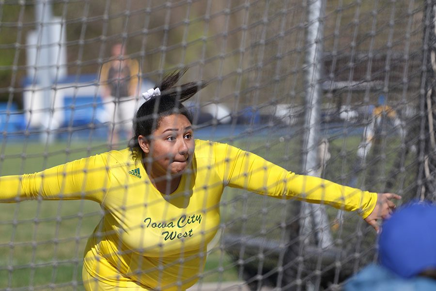 Alexie Little '20 takes her second throw during the discus competition on Thursday, April 25. Little placed 16th with a throw of 116-2.