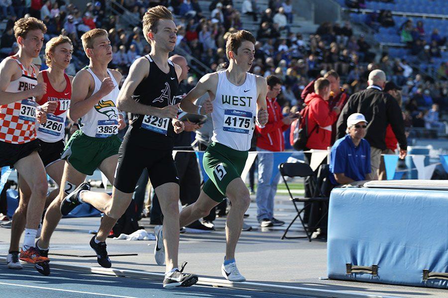 Kolby Greiner '19 runs alongside Ankeny's Tim Sindt '19 at the beginning of the 3,200 meter race on Thursday, April 25. Greiner placed 15th in 9:48.20.