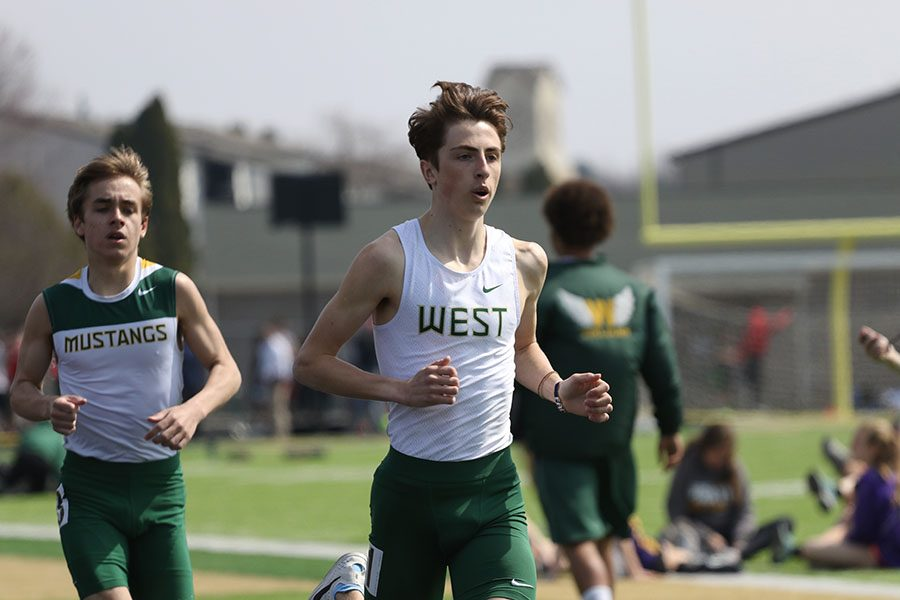 Kolby Greiner 19 runs during the 3,200 meter run with Dubuque Hempsteads Ryan Winger 21 close behind him on Saturday, April 6. Greiner won and qualified for the Drake Relays in a time of 9:32.45. He also competed in the 1,600 meter run and placed fourth with a time of 4:29.36.