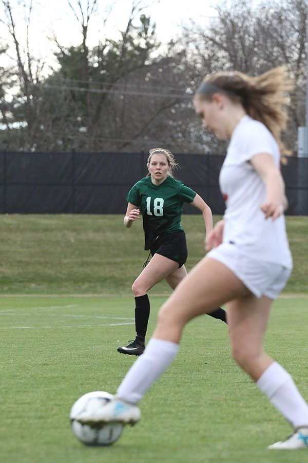 Avery Lawler 19 watches as City Highs Morgan Turner 22 dribbles the ball towards the goal during the first half on Tuesday, April 8.