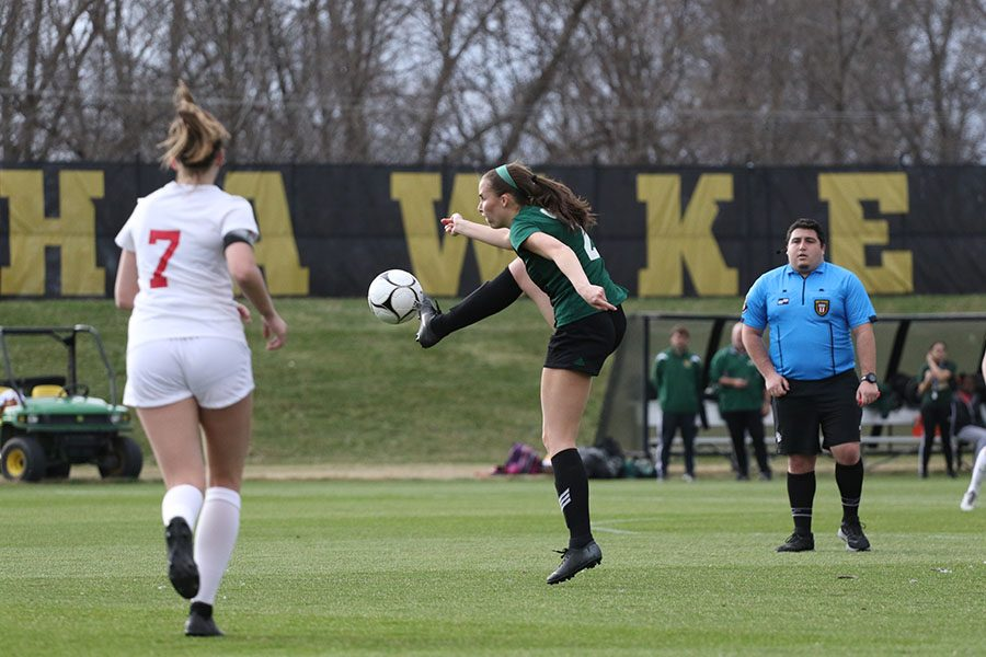 Marnie Vonderhaar 19 stops the ball in order to pass it further up the field to a teammate during the first half on Tuesday, April 9.