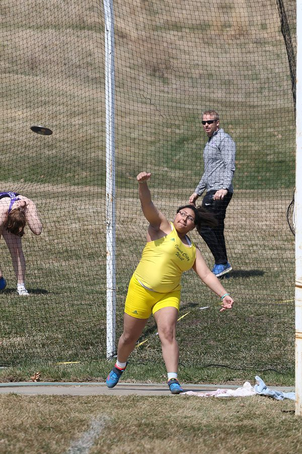 Alexie Little 20 throws the discus on Saturday, April 6. Little placed first in the discus with a throw of 121-02 and third in shot put with a throw of 37-11.00.