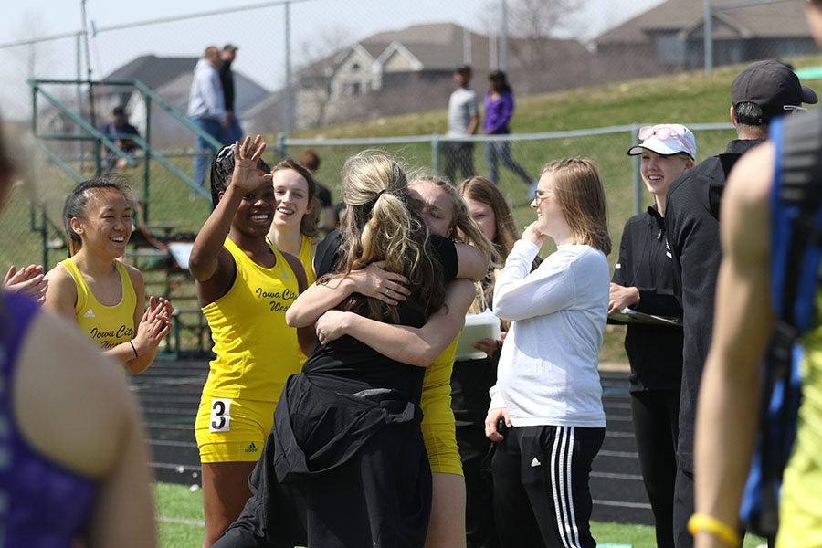 Peyton Steva 19 hugs her mom and assistant girls track coach Peggy McGuire after learning that shes the new state leader in the 100 meter hurdles on Saturday, April 6.