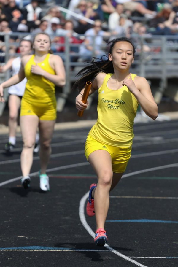 Amy Liao 21 runs the second leg of the 4x400 meter run after Katie Severt 19 passed the baton off to her on Saturday, April 6. The relay team placed first in a time of 4:14.70. Liao also ran in the first place 4x100 shuttle hurdle relay team and 4x100 meter relay team. She also placed sixth in the 100 meter hurdles in a time of 17.16.