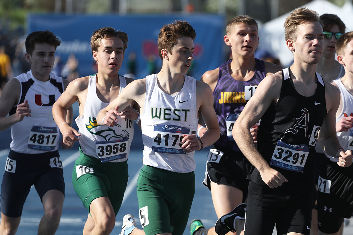 Kolby Greiner '19 runs alongside Ankeny's Tim Sindt '19 at the beginning of the 3,200 meter race on Thursday, April 25. Greiner placed 15th in 9:48.20.