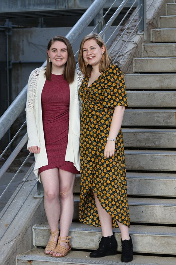 Sophie Stephens '19 and Lucy Polyak '19 lean on a staircase downtown Iowa City on Sunday, May 5.