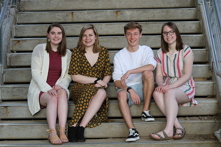 Seniors Sophie Stephens, Lucy Polyak, Will Conrad and Maddi Shinall pose on a set of stairs downtown Iowa City on Sunday, May 5.