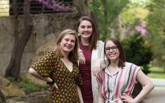 Seniors Lucy Polyak, Sophie Stephens and Maddi Shinall stand together wearing their fancy attire downtown Iowa City on Sunday, May 5.