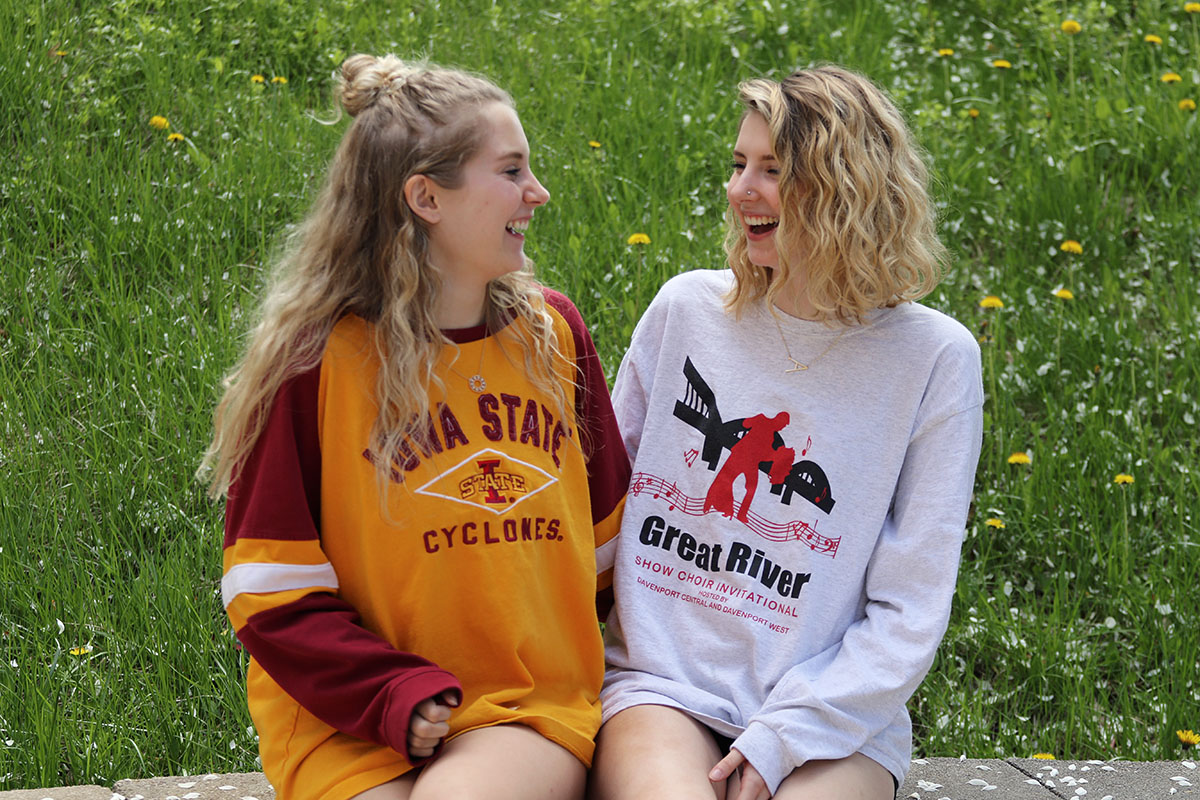 Seniors Lexi Moore and Allie Harvey share a laugh in the courtyard on Monday, May 6.