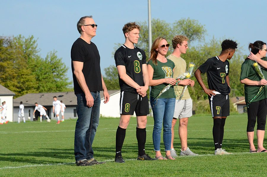 Colsen+Krupp+%2719+stands+receiving+recognition+on+senior+night.