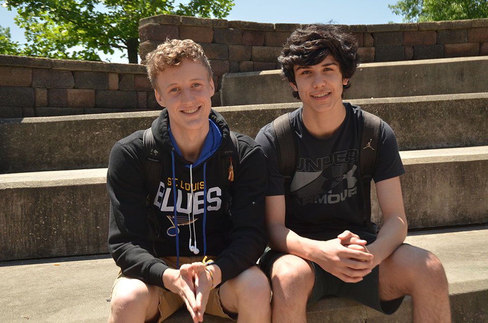 WSS staffer Ken Wilbur and Rabi Alaya '20 pose for a picture in the  West High courtyard.
