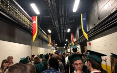Students and attendees gather in the tunnels of Carver Hawkeye Arena to take shelter.