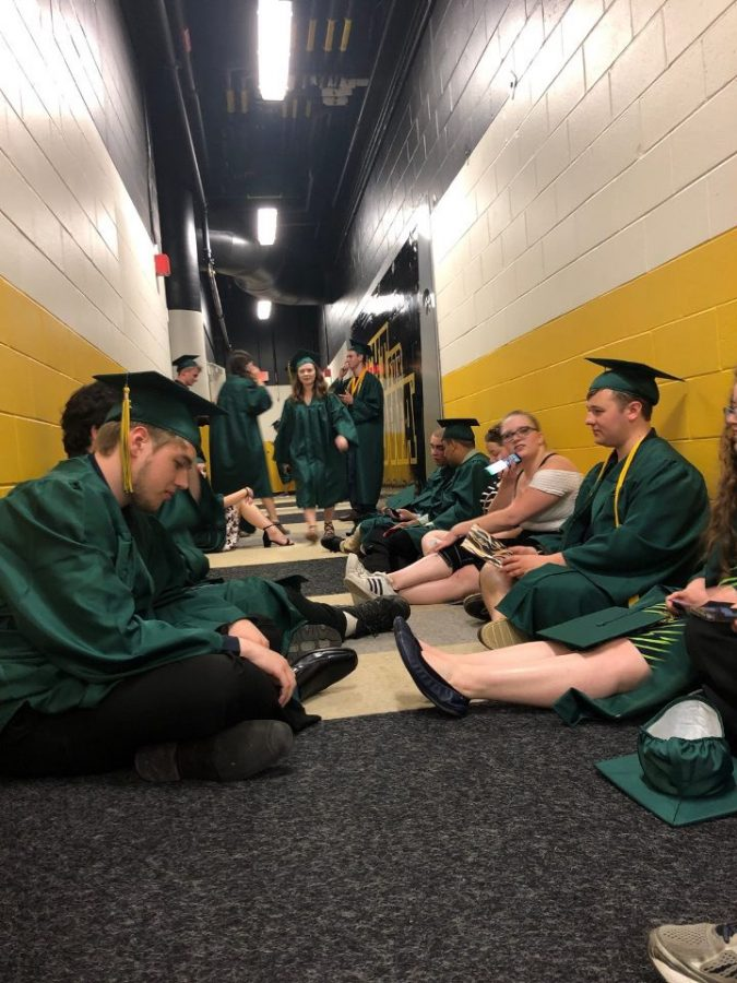 Students+sit+in+tunnel+of+Carver+Hawkeye+arena+to+take+shelter+from+the+storm%2C+awaiting+further+instruction.