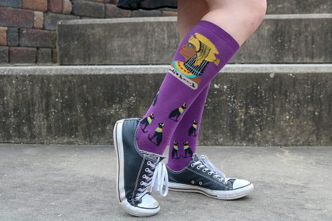 McKenna Proud '21 flaunts her favorite pair of socks. This pair features Cleopatra and Egyptian cats against a purple background. Proud's love for Cleopatra stems from her childhood.