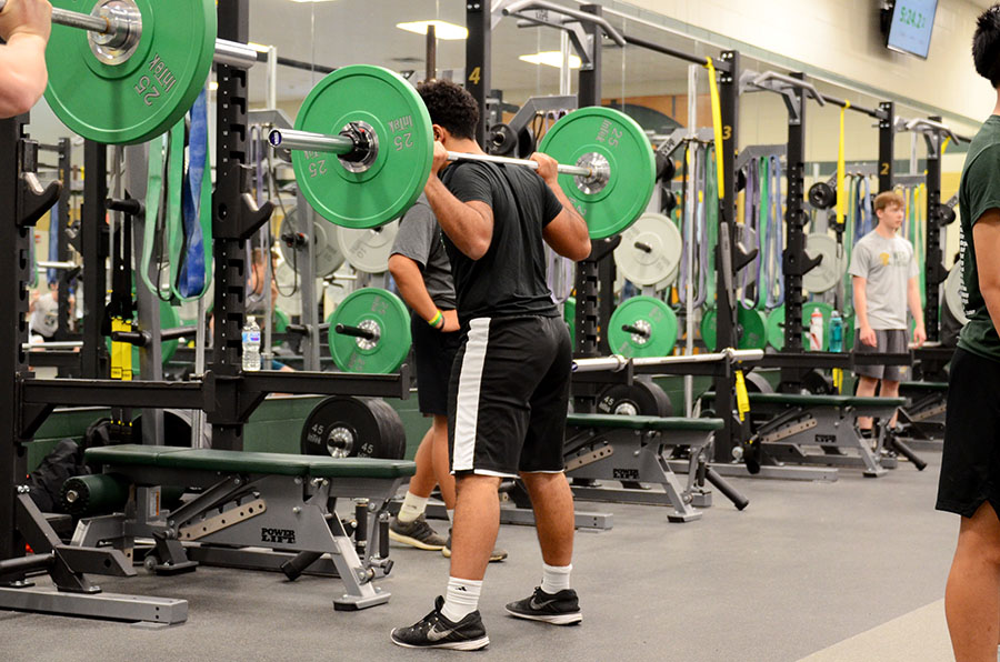 Ali Alwahdani '20 back squats during his football weightlifting session.