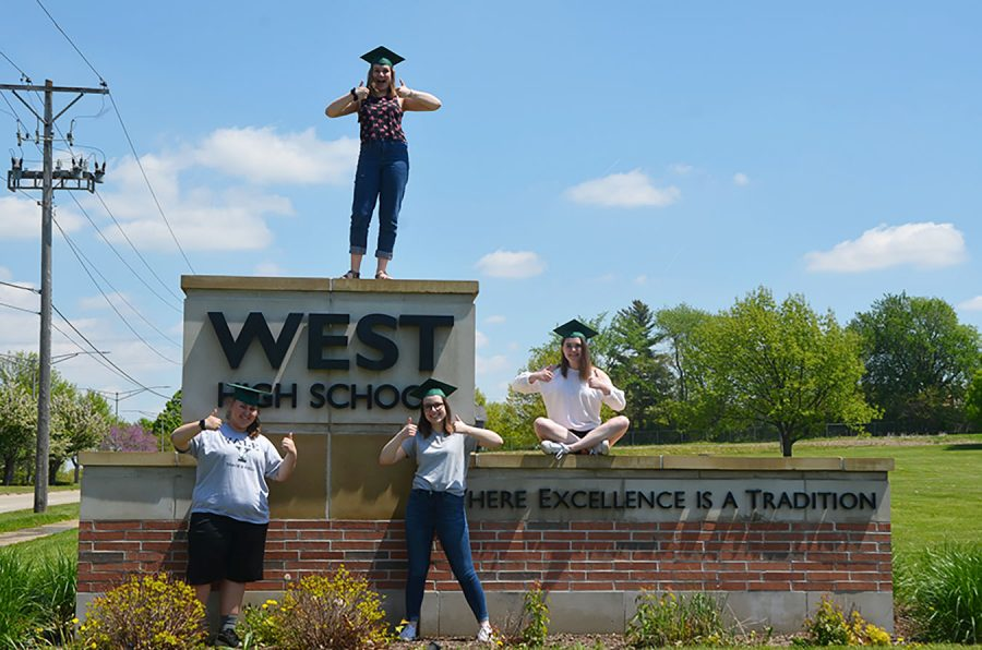 Kara Wagenknecht 19, Lucy Polyak 19, Maddi Shinall 19 and Sophie Stephens 19 pose at the West High sign outside of the school.