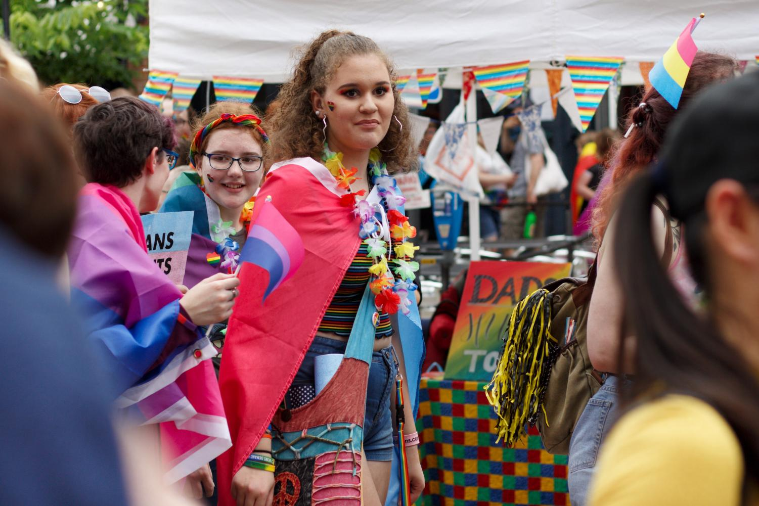 Catty+Jones+%E2%80%9822+and+Heidi+Schmidt-Rundell+%E2%80%9921+walk+in+the+Pride+Parade.+In+colorful+attire%2C+they+joined+hundreds+of+others+to+represent%2C+support%2C+and+celebrate+the+diverse+Iowa+City+community.