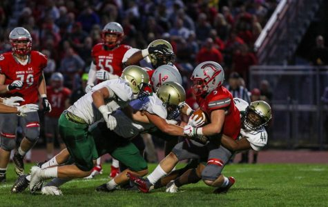 Trojans fall to North Scott 14-7 in season opener