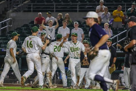 West players celebrate after an inning in the field against Pleasant Valley.