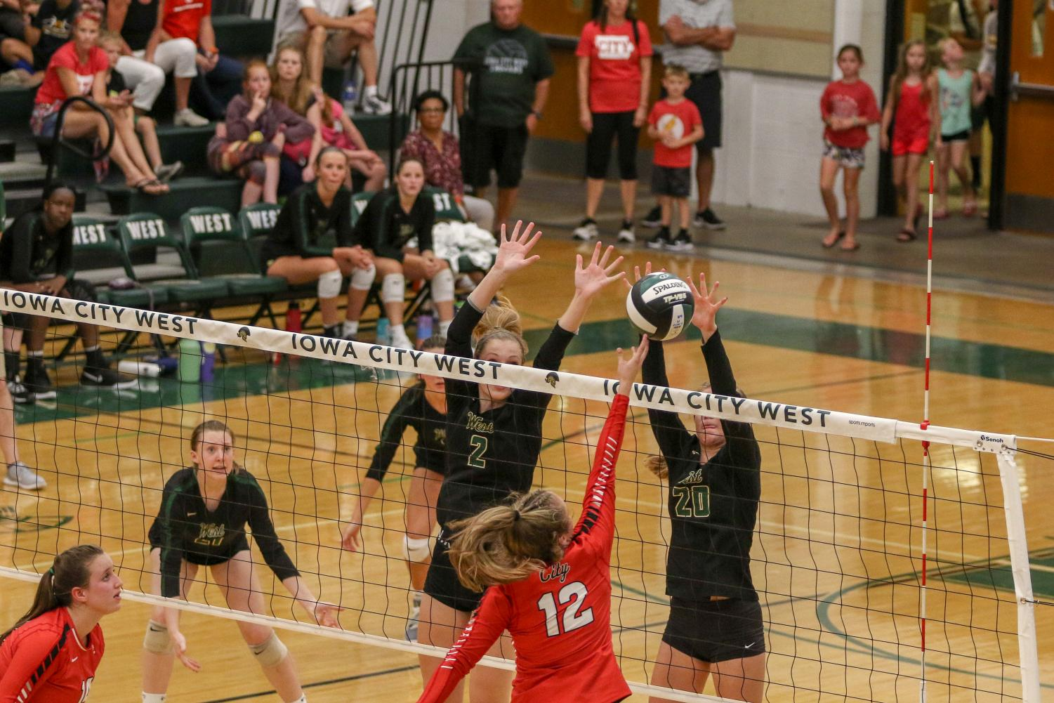 Natalie+Young+%2720+and+Ryann+Culver+%2721+block+the+ball+for+a+point+on+Tuesday%2C+August+27+during+the+Battle+for+the+Spike.