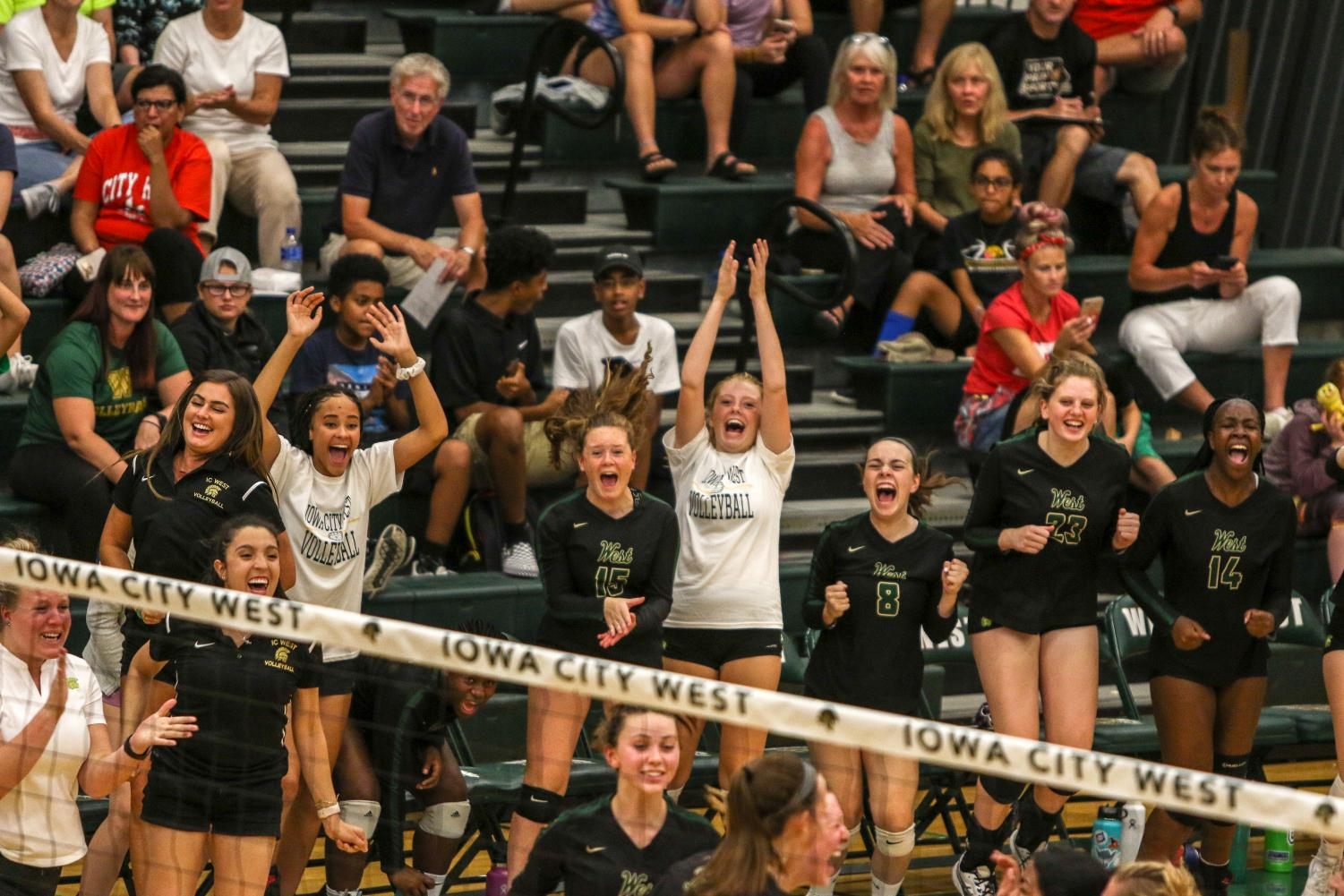 The+rest+of+the+team+and+coaches+celebrate+a+point+on+Tuesday%2C+August+27+during+the+Battle+for+the+Spike.