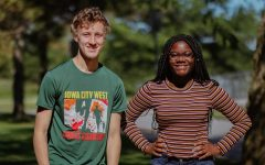 Ken Wilbur '20 and Mami Selemani '20  pose for a photo on the front lawn after finishing their podcast.