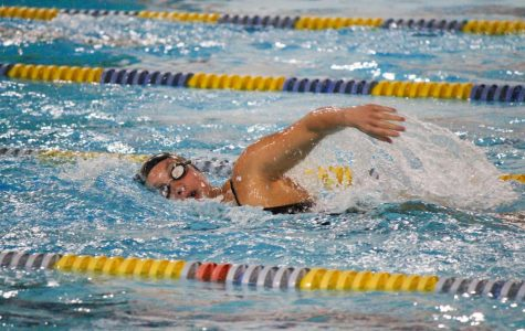 Aurora Roghair '21 competes in a relay during the girls home sweet meet at the Coralville Recreation Center on Sept. 17. Roghair is working on developing her leadership skills as she heads into her senior season.