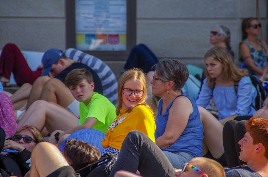 Emma Barker 22 sits down during the die-in. Participants remained completely silent for 11 minutes.