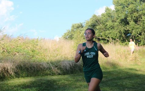 Emma Kearney '21, runs at the first and only home meet of the season.