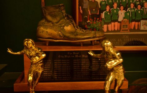 The Boot sits proudly in the trophy case of West High. It is a symbol of a storied rivalry.