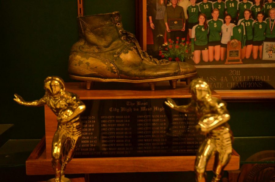 The+Boot+sits+proudly+in+the+trophy+case+of+West+High.+It+is+a+symbol+of+a+storied+rivalry.