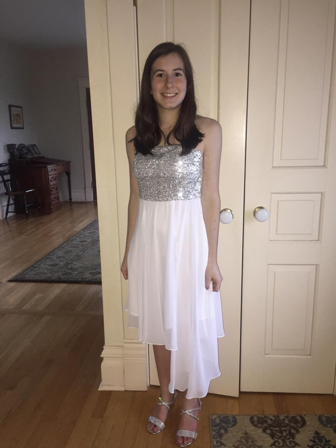 Eight grade Maia DeGrazia '20 poses in her eight grade formal dress, the same one her mother was tailoring when she realized her shoulders weren't aligned.