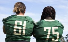 Phoebe Burt '21 and Salima Omari '20 stand side by side as the only two girls on the football team.