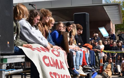 Greta Thunberg sits alongside students activists during the silent 11 minute sit down.