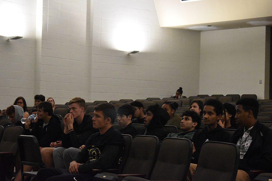 Students listen as Garrett Hartwig unveils the team rankings in reverse order.