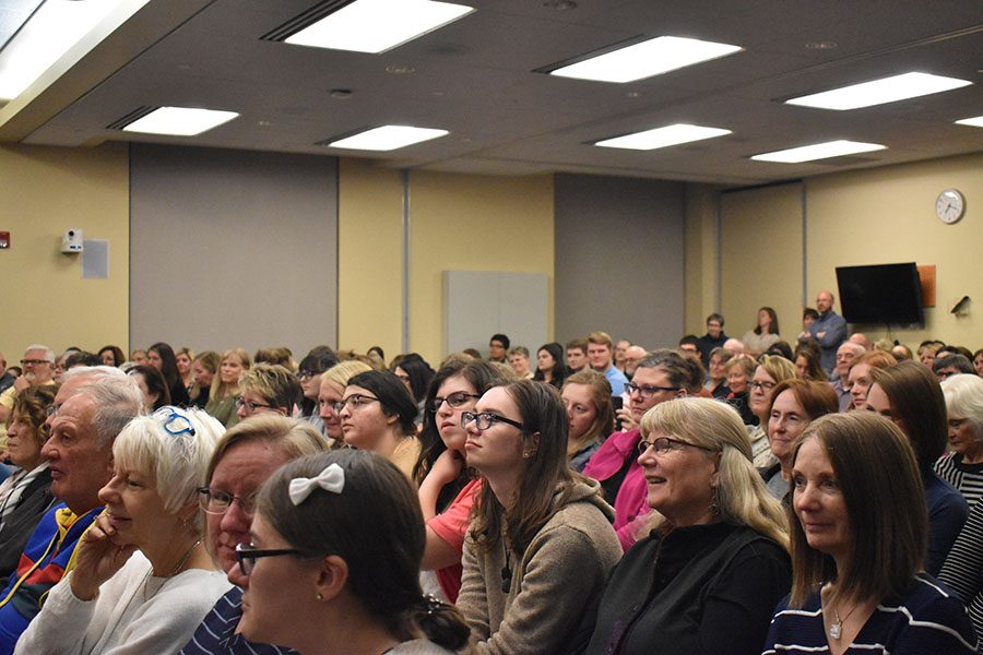 A sea of faces listen as Australian author Mark Zusak, reads from his first book,