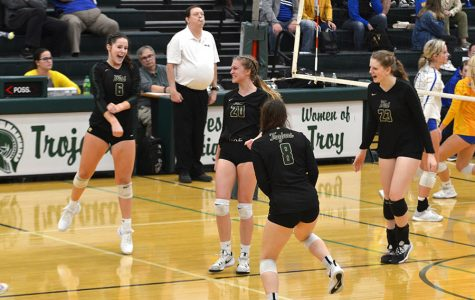 The team celebrates after scoring a point against Dubuque Wahlert on Oct. 8 at West High.
