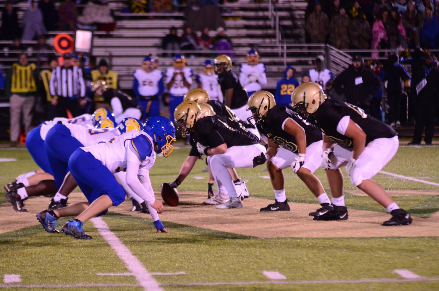 The offensive line sets up before a crucial third down play against Davenport North on Oct. 11 at Trojan Field.