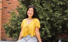 Claudia Chia '20 poses in her thrifted outfit.