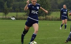 Carly Norris '21 plays in an ISC soccer game in the 2018 season.